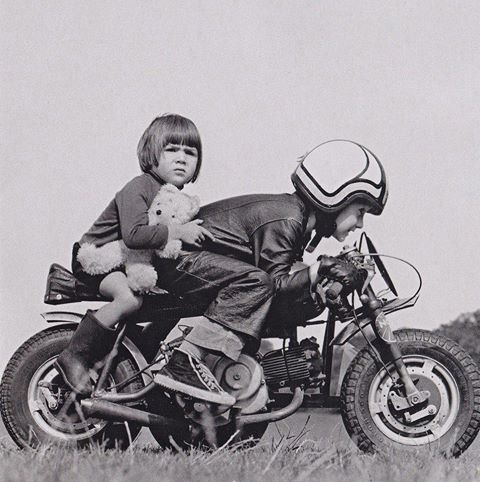 OLD IMAGE OF TWO KIDS PRETENDING TO BE RIDING ON MOTORCYCLE